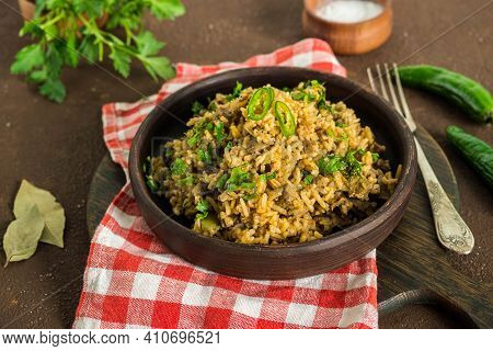 Dirty Rice, Cajun Cuisine Dish, Rice With Liver, Minced Pork, Green Pepper And Spices In A Clay Plat