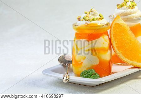 Dessert Of Low-fat Cottage Cheese And Orange Mousse Is Served In Glass Jars With Pieces Of Pistachio