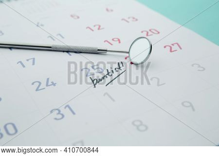 Dental Health And Teethcare Concept. Dentist Appointment In Calendar And Professional Dental Tools.