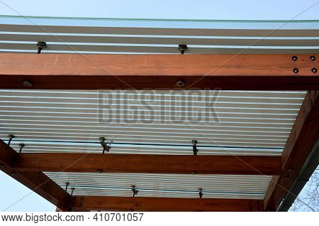 Wooden Structure Of The Bus Stop, The Shelter Of The Gazebo Pergola. The Roof And Walls Are Lined Wi