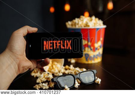 Tula Russia 16.01.20: Netflix On The Phone Screen And Popcorn With Glasses On The Table.