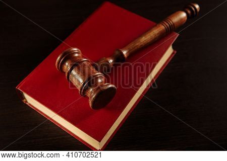 Juridical Library On The Table. Wooden Gavel And Books.