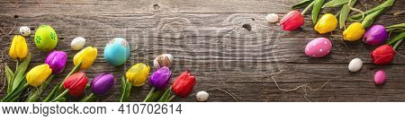 Painted Eggs With Tulips On Natural Wooden Plank. Easter Decoration