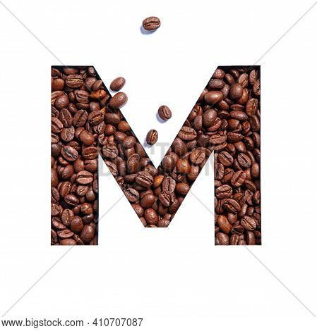 Letter M Of English Alphabet Made Of Coffee Beans And Paper Cut Isolated On White. Typeface For Coff