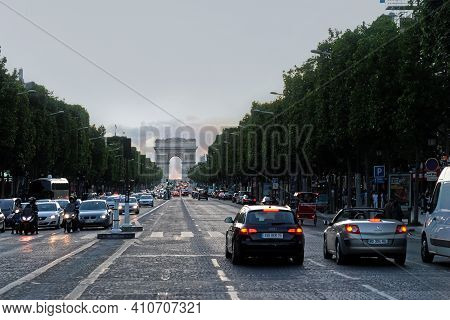 Paris, France, June 21: Traffic On The Champs Elysees Overlooking The Arc De Triomphe In The Late Ev