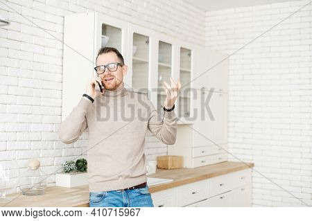 Portrait Of Successful Young Businessman Talking On Mobile Phone, Solving Important Issues Related T