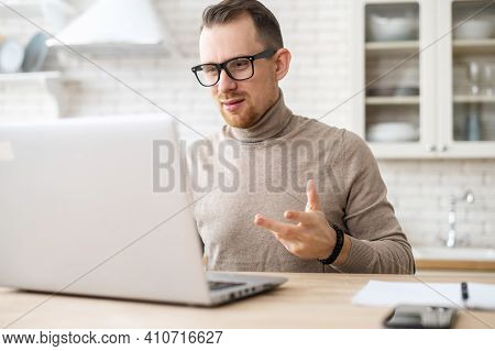 Confident Businessman With Glasses Sitting At Desk, Making Conference Video Call On Laptop Web Cam,