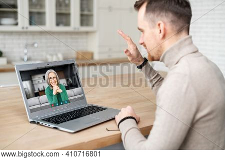 A Mature Man Talking To His Mom Via Video Call, Using Laptop, Saying Goodbye, Waving Hand, Happy To