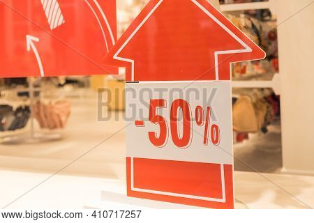 Discounts In The Shopping Center. Discount, 50 Percent Sign In Shopping Mall.promotion Tag In Clothe