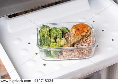 Ready Frozen Meal In A Container In The Refrigerator. Frozen Food In The Freezer. Fast Cooking Conce
