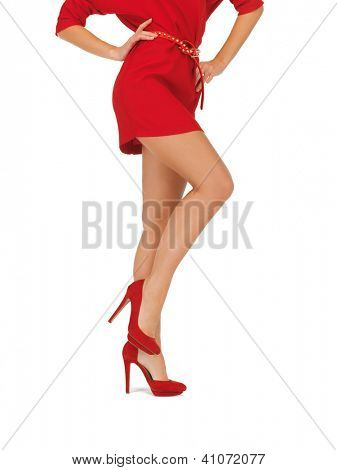 closeup picture of woman in red dress on high heels