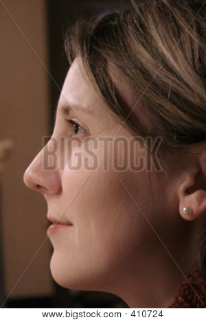 Young Woman Looks Up