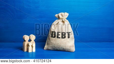 Family Figurines And Debt Money Bag. Financial Literacy. Arrears Difficult Financial Situation. Debt