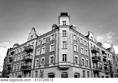 Facades With Balconies Of Historic Tenement Houses In The City Of Poznan, Monochrome
