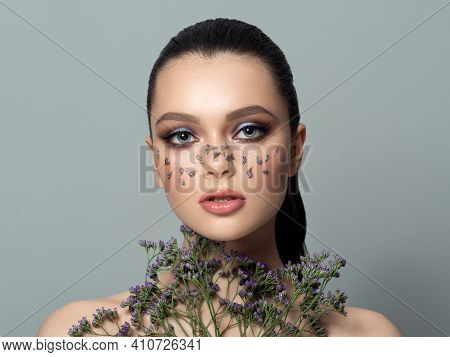Fashion Portrait Of Young Beautiful Woman With Fashion Floral Makeup