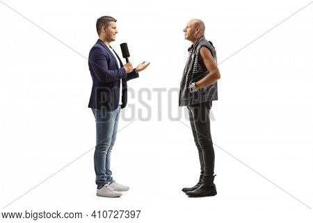 Young male reporter interviewing a punk rocker man isolated on white background