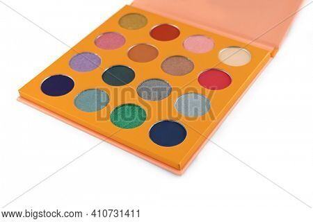 Colorful eye shadow palette isolated on white background, selective focus