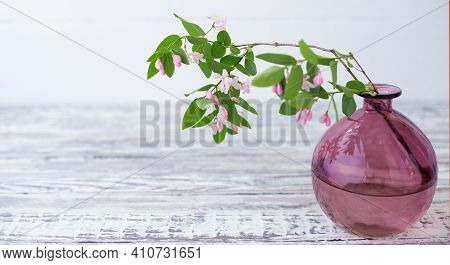 Blooming Spring Branches Of Flowers In Glass Pink Vase On Wooden Vintage White Background With Copy