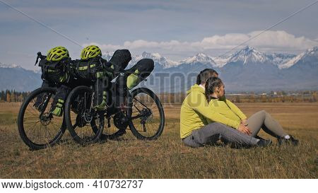 The Man And Woman Travel On Mixed Terrain Cycle Touring With Bikepacking. The Two People Journey Wit