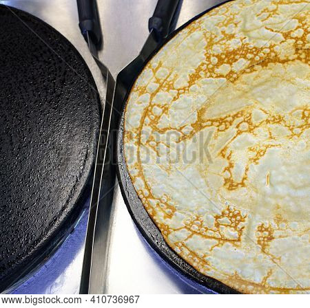 Pancake On Frying Pan View From Above In A Cafe