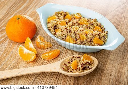 Tangerine, Slices Of Tangerine, Light-blue Oval Bowl With Boiled Quinoa And Pieces Of Tangerines, Sp
