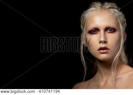 Close Up Beauty Portrait Of Young Woman With Red Smokey Eyes Over Black Background. Perfect Skin And