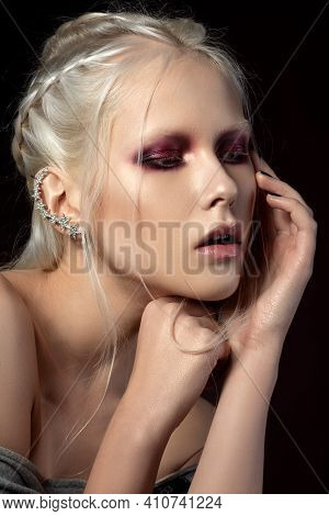 Beauty Portrait Of Young Blonde Woman With Fashion Red Smokey Eyes Makeup