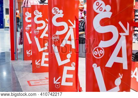 Red Bright Sale Banner On Anti-thieft Gate Sensor At Retail Shopping Mall Entrance. Seasonal Discoun