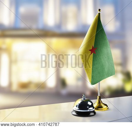 French Guiana Flag On The Reception Desk In The Lobby Of The Hotel