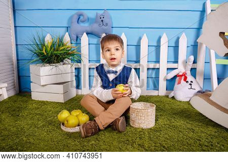 Portrait Of Adorable Funny Boy. Picnic In Nature. Cute Funny Little Boy With Wicker Basket. Kid Is G
