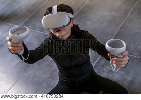 Woman Sitting On Floor In Lotus Position In Wireless 360 View Virtual Reality Headset. 3D Device Gad