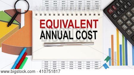 Notebook With Tools And Notes Text Equivalent Annual Cost With Chart