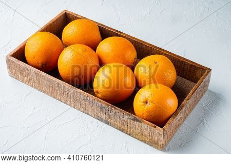 Raw Organic Cara Navel Oranges Set, In Wooden Box, On White Stone  Background , With Copyspace  And