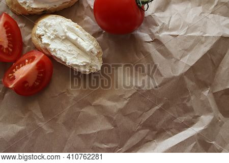 A Whole Tomato Next To The Sandwiches. Space For Text Bottom.
