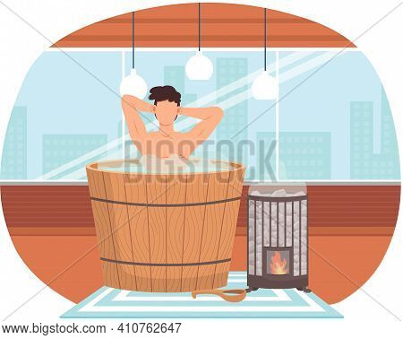 Young Man Sitting In Tub. Bathhouse Or Banya At Home Interior Design. Sexy Guy In Barrel Is Resting