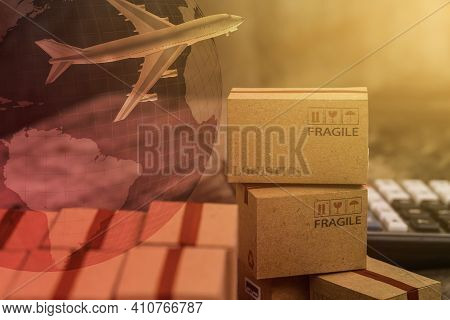 Packing Light Brown Cardboard Boxes With World Map. An Idea Of International Freight Or Shipping Ser