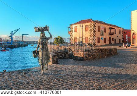 Puerto De La Cruz, Tenerife,spain  - June 06, 2018:   La Pescadora, Bronze Monument Dedicated To The