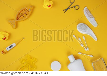 Baby Accessories For Bathing On Yellow Background, Flat Lay. Composition With Baby Accessories And S