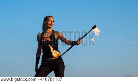 Happy Sexy Fire Performer Woman Manipulate Flaming Baton On Blue Sky Outdoors, Performance