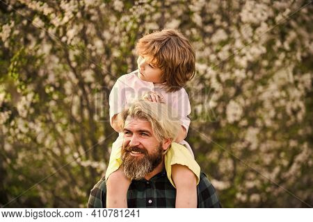 Happy Family. Little Boy And Father In Nature Background. Springtime. Hipster Piggybacking Baby. Bea