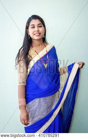 Beautiful Nepali Woman With Beautiful Dress Up With Traditional Ornaments. Portrait Of A Nepali Girl