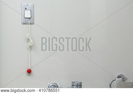 Nurse Call In A Toilet For Patient Pull The Rope Or Press The Button For Help. Emergency Pull Or Pus