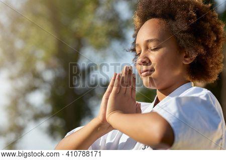 Cute Little Girl Doing Meditation Exercise Outdoors