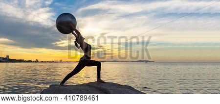 Silhouette Healthy Woman Yoga Ball Balance Body Exercising Vital Meditate And Practicing On The Rock