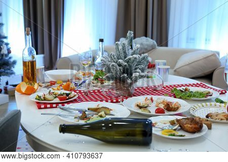 Dirty Dishes On White Table In Room. Mess After New Year Party