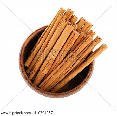 Aromatic Dry Cinnamon Sticks In Bowl On White Background, Top View