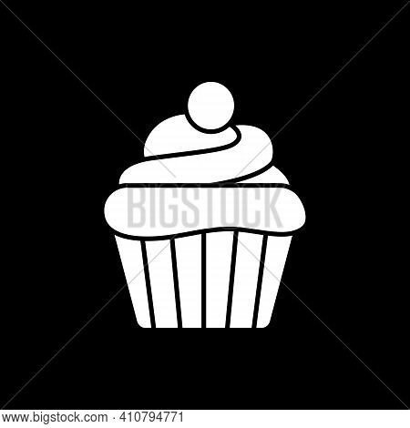 Cupcake Dark Mode Glyph Icon. Sweet Muffin With Frosting. Bakery Goods. Pastry And Treats. Culinary