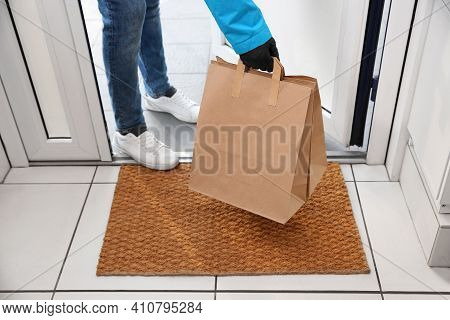 Courier Bring Paper Bags With Takeaway Food To Doorway, Closeup. Delivery Service During Quarantine