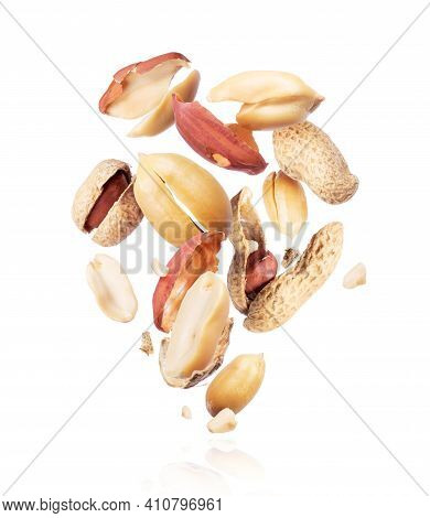 Crushed Peanuts Are Hanging In The Air Close-up On A White Background