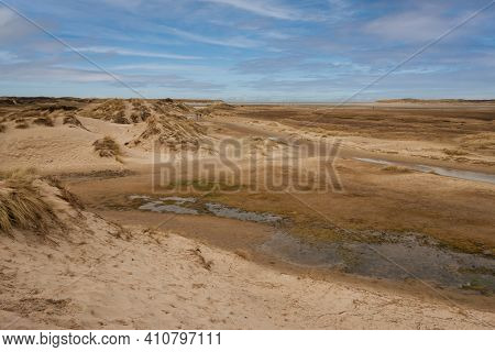 Walking Through The Slufter Valley On The Wadden Island Of Texel, A Sandy Plain That Is Openly Conne
